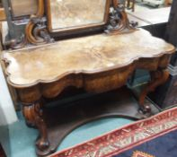 A Victorian walnut dressing table, 143cm high x 120cm wide x 52cm deep Condition Report: Available