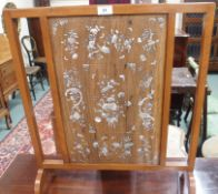 A firescreen with mother of pearl inlaid panel, 67cm high x 56cm wide Condition Report: Available