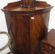 A mahogany bow front corner cabinet, 124cm high x 80cm wide Condition Report: Available upon