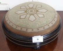 A Victorian ebonised circular footstool Condition Report: Available upon request