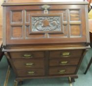 A mahogany bureau with carved lid and six drawers, 114cm high x 80cm wide Condition Report: