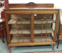 A mahogany display cabinet on ball and claw feet, 124cm high x 122cm wide Condition Report: