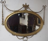 An oval gilt wall mirror,walnut mirror, circular mirror and an inlaid oval mirror (4) Condition