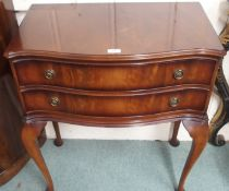 A reproduction mahogany two drawer table, 80cm high x 72cm wide Condition Report: Available upon