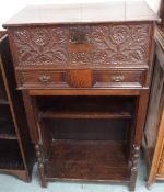 A carved oak bible box on latter stand Condition Report: Available upon request
