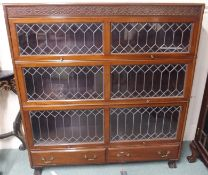 A mahogany three section leaded glass stacking bookcase with two lower drawers, 138cm high x 128cm