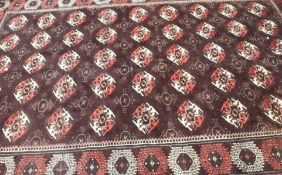 A dark ground Turkeman rug, 309cm x 190cm Condition Report: Available upon request