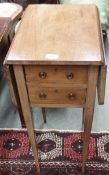 A small mahogany two drawer table with drop flaps Condition Report: Available upon request