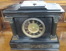 A black slate mantle clock Condition Report: Available upon request