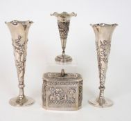 A PAIR OF CHINESE SILVER SPILL VASES decorated with prunus, beneath a wavy rim, stamped marks, 164