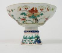 A CHINESE STEMMED CUP painted with peonies above a band of waves, 10cm high and 14cm diameter