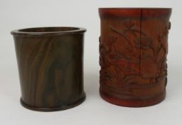 A CHINESE BAMBOO BRUSHPOT carved with lilies and foliage, 15.5cm high and a hardwood brushpot,