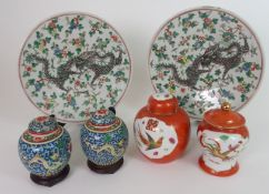A PAIR OF CHINESE FAMILLE VERTE DISHES painted with a scrolling dragon amongst foliage, 30cm