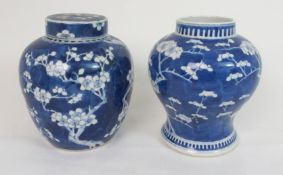 A CHINESE BLUE AND WHITE GINGER JAR AND COVER painted with blossoming branches, four character mark,