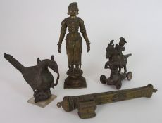AN INDIAN BRASS TEMPLE TOY with a noble figure riding his horse, 14cm high, brass bird finial,