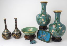 A PAIR OF JAPANESE CLOISONNE BALUSTER VASES decorated with convolvulus on a cloud pattern ground,