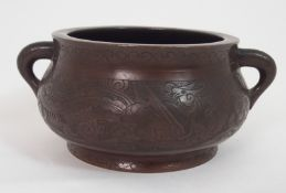A CHINESE BRONZE TWO HANDLED CENSOR decorated with two panels with dragons and a phoenix amongst