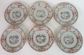 A SET OF SIX CHINESE EXPORT PLATES each painted with landscape roundels, within bands of trellis and