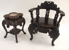 A CHINESE EBONISED ARMCHAIR the back rest carved with dragons above curved arms, supported on five