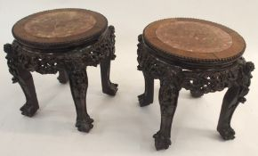 A PAIR OF CHINESE HARDWOOD CIRCULAR PEDESTAL TABLES inset with marble tops above pierced foliate