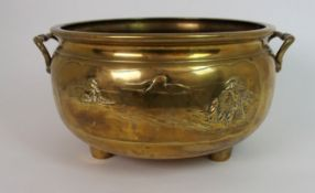 A LARGE CHINESE BRASS TWO HANDLED JARDINIERE cast with two landscape panels and fixed with conjoined