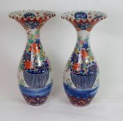 A PAIR OF ARITA BALUSTER VASES each printed and painted with baskets of flowers, beneath frilled