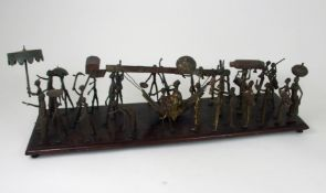 A DAHOMEY PROCESSIONAL GROUP, BENIN in brass and wood, with twenty nine figures, mounted on a
