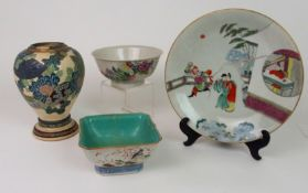 A CHINESE DISH AND TWO BOWLS the dish painted with figures on a balcony amongst bamboo and rockwork,