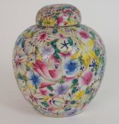 A CHINESE MILLEFIORI JAR AND COVER painted all over with brightly coloured flowers, red six