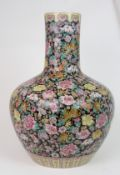 A LARGE CANTON MILLIEFIORI PATTERN BALUSTER VASE painted with allover floral design, within yellow
