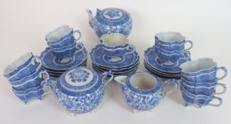 A JAPANESE BLUE AND WHITE TEA SERVICE finely painted all over with Ho-o birds and scrolling foliage,
