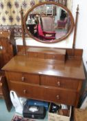 A walnut dressing chest with oval mirror Condition Report: Available upon request