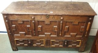 An oak coffer with panel front with two lower drawers and S A carved initials, 73cm high x 132cm