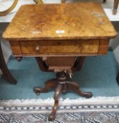 A Victorian walnut sewing table on carved base Condition Report: Available upon request