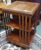An inlaid mahogany revolving bookcase, 80cm high Condition Report: Available upon request