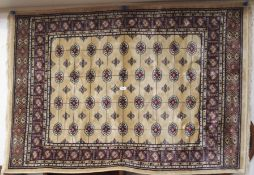 A light ground Bokhara rug, 115cm x 165cm Condition Report: Available upon request