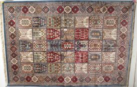 A Kashmir rug with with panel design, 170cm x 118cm Condition Report: Available upon request