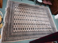A light ground Bokhara rug, 260cm x 327cm Condition Report: Available upon request