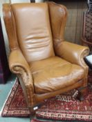 A John Lewis Compton tan leather wingback armchair Condition Report: Available upon request
