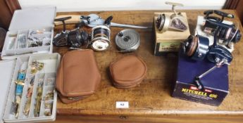 A selection of fishing tackle including rods, reels (Mitchell 406, Garcia Mitchell 602A etc)