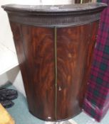 A 19th Century mahogany bow front corner cabinet, 104cm x 59cm Condition Report: Available upon
