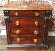 A miniature Victorian mahogany four drawer chest, 54cm high x 50cm wide x 29cm deep Condition