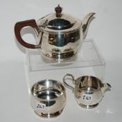 A three piece silver tea service, London 1932, 801gms Condition Report: Available upon request
