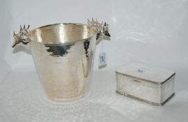 A lot comprising a silver plated ice pail with stag's head handles and a silver plated box (2)