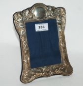 A silver mounted photo frame, Sheffield 1991, rectangular with flowerheads and leafy tendril