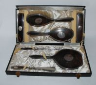 A cased seven piece silver and tortoiseshell dressing table set, Birmingham 1923 Condition Report: