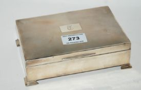 A silver cigarette box, Birmingham 1947, rectangular with engine turned decoration, the hinged cover