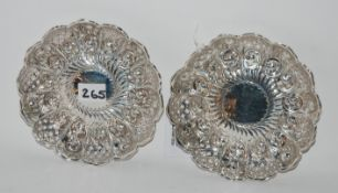 A pair of silver dishes, Sheffield 1895, of circular form with scalloped rim and pierced and foliate
