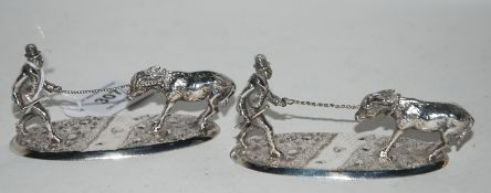 A pair of silver plate figure groups modelled as a farmer leading a donkey, each 10cm long Condition