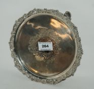 A silver card tray, Sheffield 1913, of circular form with central blank cartouche on three scrolling